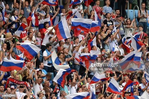 TOPSHOT Russia supporters cheer during the 2017 Confederations Cup group A football match between Russia and New Zealand at the Krestovsky Stadium in...