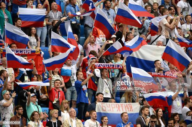 Russia supporters cheer during the 2017 Confederations Cup group A football match between Russia and New Zealand at the Krestovsky Stadium in...
