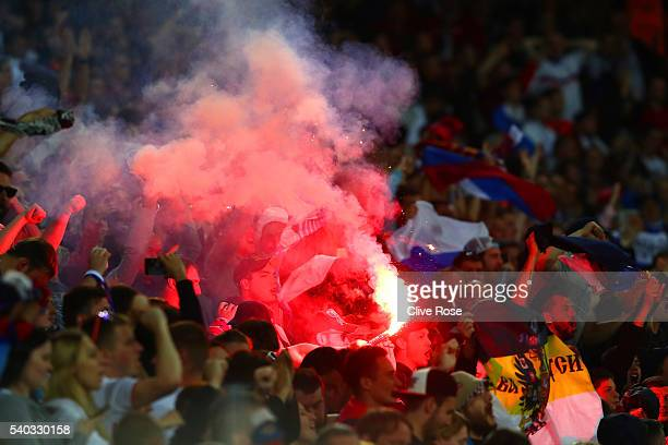 Russia supporters set of a red flare during the UEFA EURO 2016 Group B match between Russia and Slovakia at Stade PierreMauroy on June 15 2016 in...