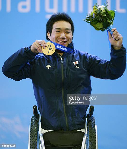 SOCHI Russia Takeshi Suzuki of Japan holds up his gold medal during the medal ceremony for the alpine skiing men's slalom sitting event at the 2014...
