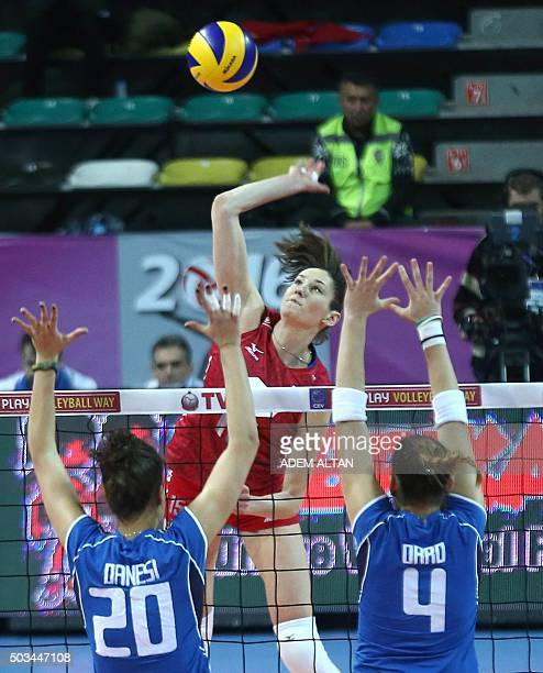 Russia Tatiana Kosheleva smashes as Italy Alessia Orro and Anna Danesi block during the Women's European Olympic Qualification volleyball match on...