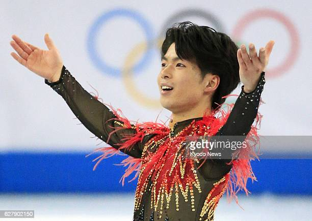 SOCHI Russia Tatsuki Machida of Japan winner of the Cup of Russia and Skate America responds to cheers after finishing his performance in the men's...