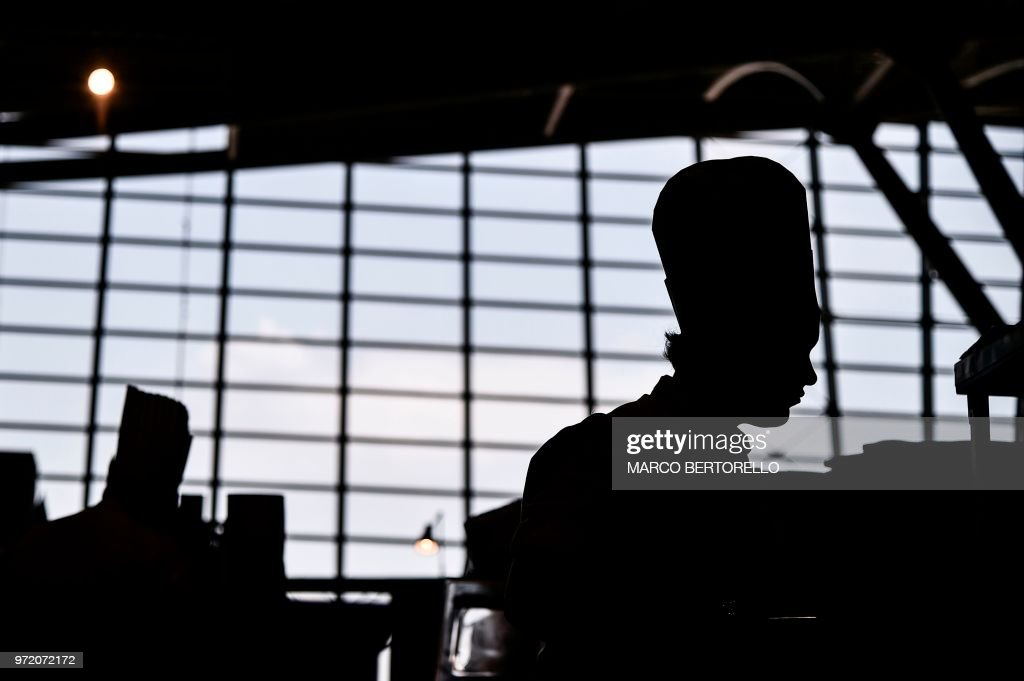 Russia team member is silhoutted during the event of the Bocuse d'Or Europe 2018 International culinary competition, on June 12, 2018 in Turin.