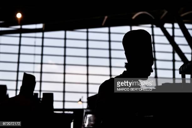 Russia team member is silhoutted during the event of the Bocuse d'Or Europe 2018 International culinary competition on June 12 2018 in Turin