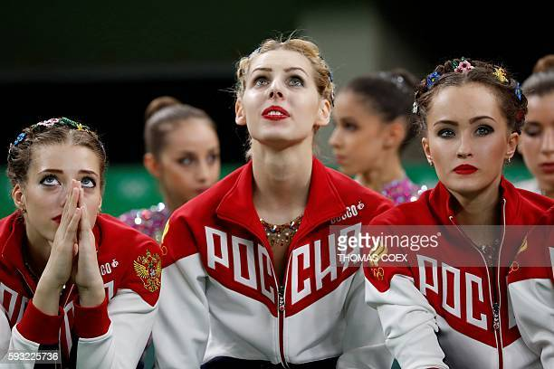 TOPSHOT Russia' team react after competing in the group allaround final event of the Rhythmic Gymnastics at the Olympic Arena during the Rio 2016...