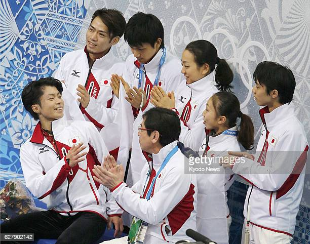 SOCHI Russia Teammates applaud Tatsuki Machida of Japan after his performance in the men's free skating segment of the Winter Olympic Games figure...