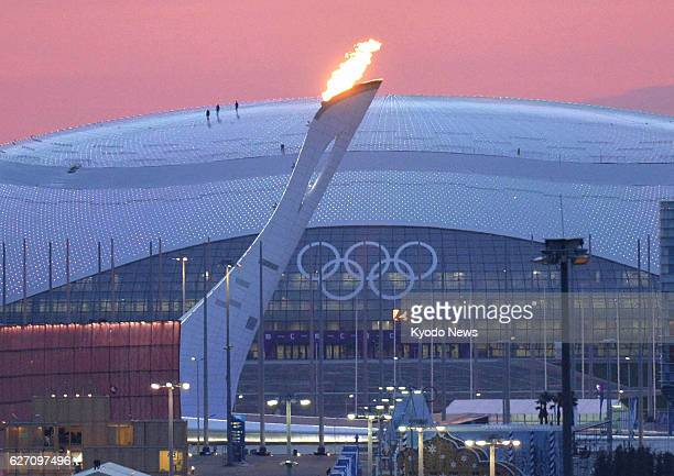 SOCHI Russia The Olympic flame cauldron is lit during a test ignition at the Olympic Park in Sochi Russia on Jan 27 before the Winter Games open the...