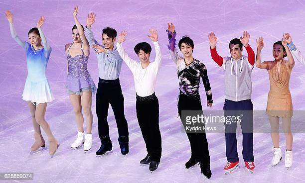 SOCHI Russia Top figure skaters at the Sochi Winter Olympics in Russia wave to the audience during a gala exhibition on Feb 22 2014 South Korea's Kim...