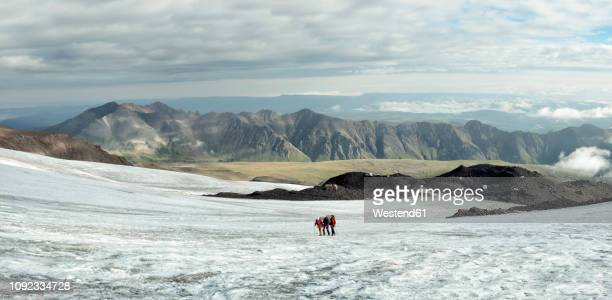 russia, upper baksan valley, caucasus, mountaineers ascending mount elbrus - snowfield stock pictures, royalty-free photos & images