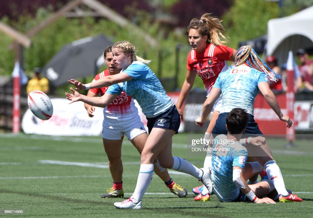 Russia (blue) vs France (red) in HSBC Canada Women's Sevens Rugby action at Westhills Stadium in Langford, BC, May 27, 2017. / AFP PHOTO / Don MacKinnon