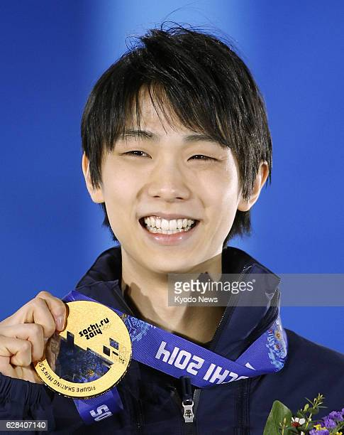 SOCHI Russia Yuzuru Hanyu of Japan smiles at the awards ceremony after winning the gold medal in the men's figure skating event at the Winter...