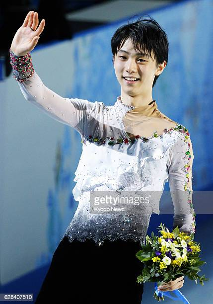 SOCHI Russia Yuzuru Hanyu of Japan waves to the audience after winning the men's figure skating competition at the Sochi Winter Olympics in Russia on...