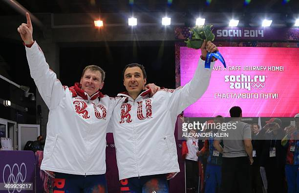 Russia1 twoman bobsleigh pilot Alexander Zubkov and brakeman Alexey Voevoda celebrate their Gold Medal during the Bobsleigh Twoman Flower Ceremony at...