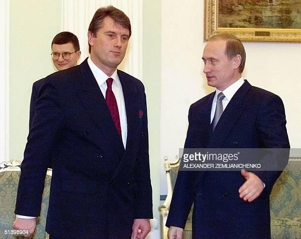 Russian acting President and Premier Vladimir Putin greets Ukrainian Premier Viktor Yushenko in Moscow's Kremlin 21 January 2000