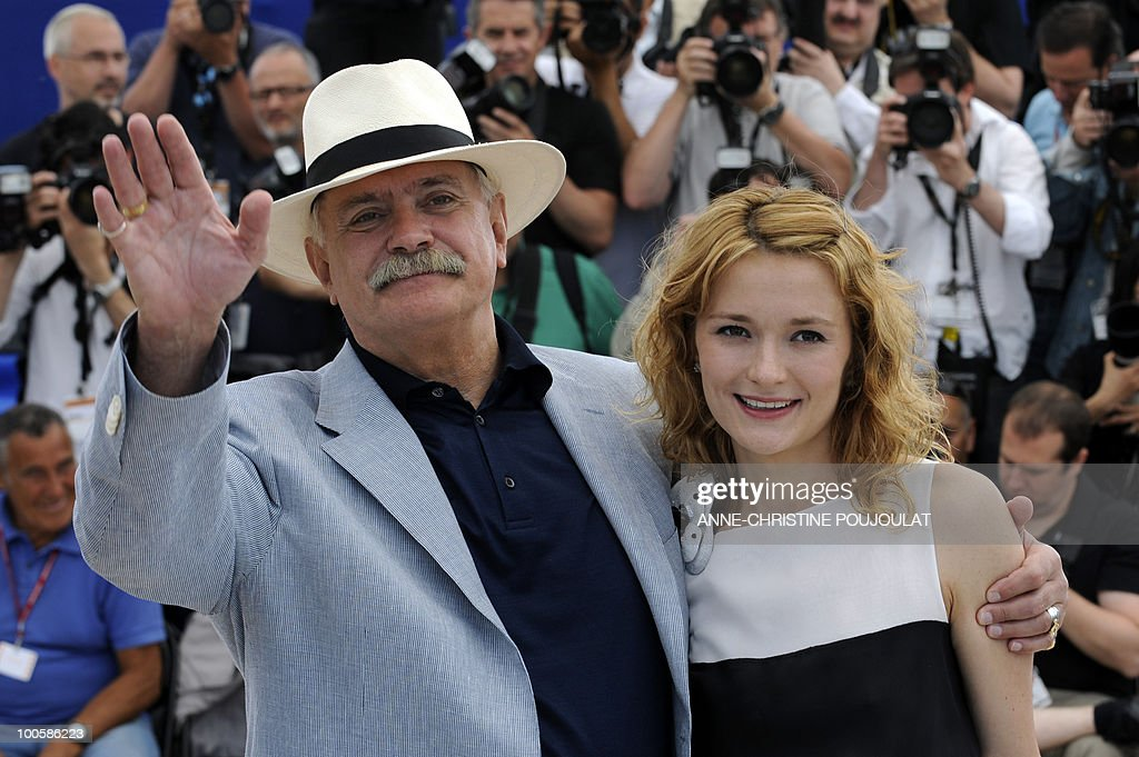 Russian actor and director Nikita Mikhalkov and his daughter Russian actress Nadezhda Mihalkova pose during the photocall of 'Utomlyonnye Solntsem 2: Predstoyanie' (The Exodus - Burnt By The Sun 2) presented in competition at the 63rd Cannes Film Festival on May 22, 2010 in Cannes.