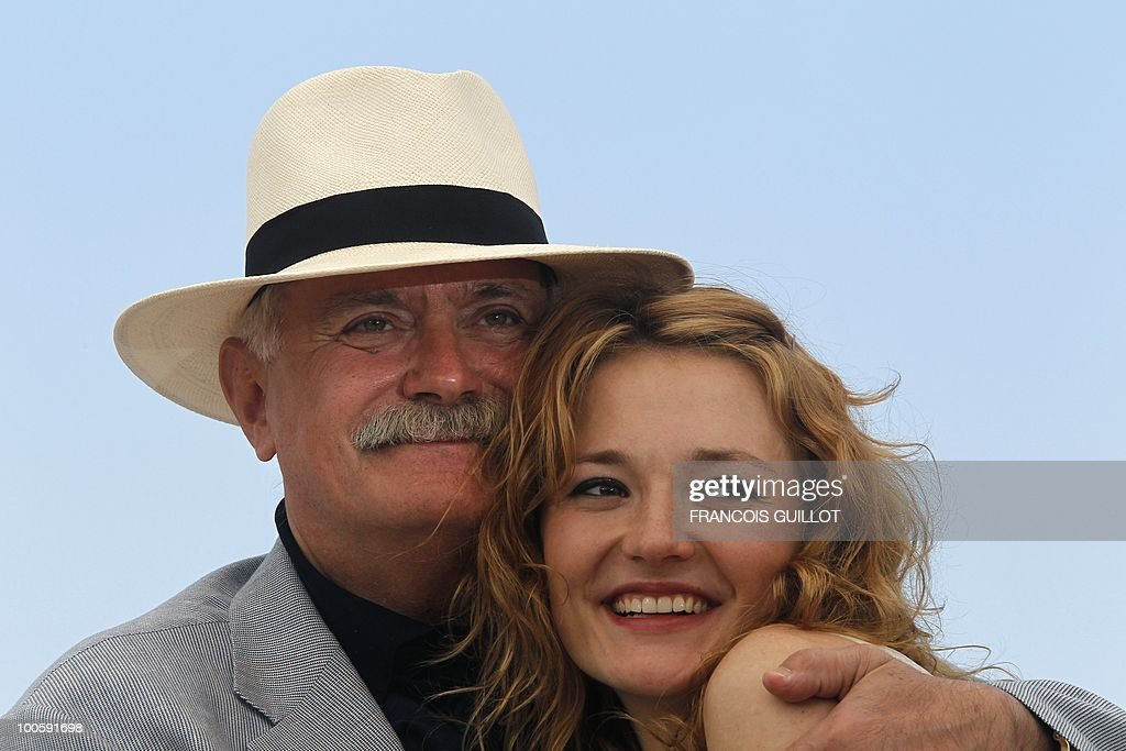 Russian actor and director Nikita Mikhalkov and Russian actress Nadezhda Mihalkova pose during the photocall of 'Utomlyonnye Solntsem 2: Predstoyanie' (The Exodus - Burnt By The Sun 2) presented in competition at the 63rd Cannes Film Festival on May 22, 2010 in Cannes.