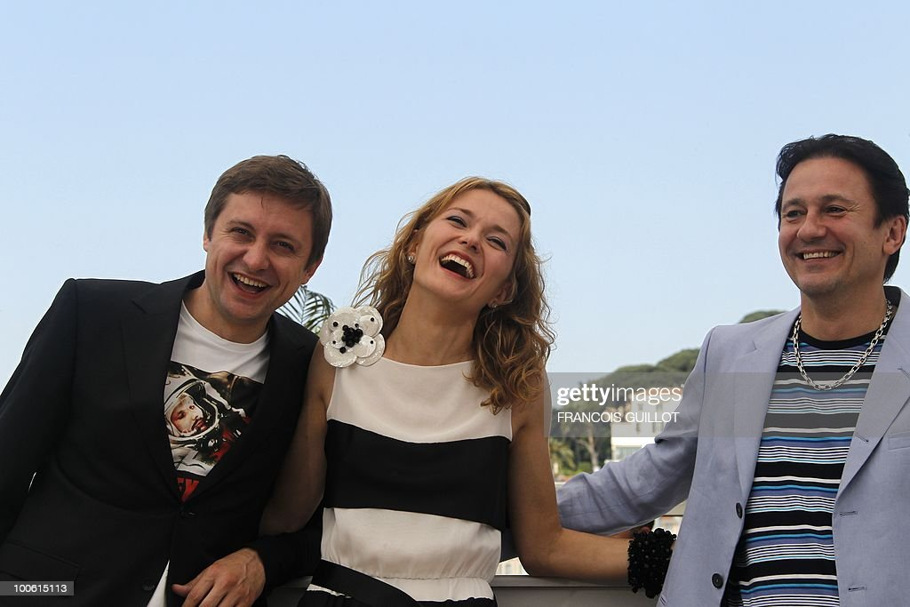 Russian actor Artem Menshikov, Russian actress Nadezhda Mihalkova and Russian actor Oleg Menshikov pose during the photocall of 'Utomlyonnye Solntsem 2: Predstoyanie' (The Exodus - Burnt By The Sun 2) presented in competition at the 63rd Cannes Film Festival on May 22, 2010 in Cannes.
