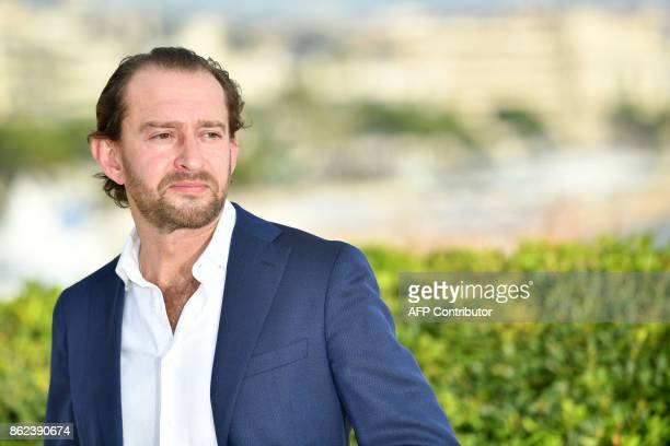 Russian actor Konstantin Khabensky poses during a photocall for the TV drama drama dedicated to Trotsky in the history of Russia during the MIPCOM...