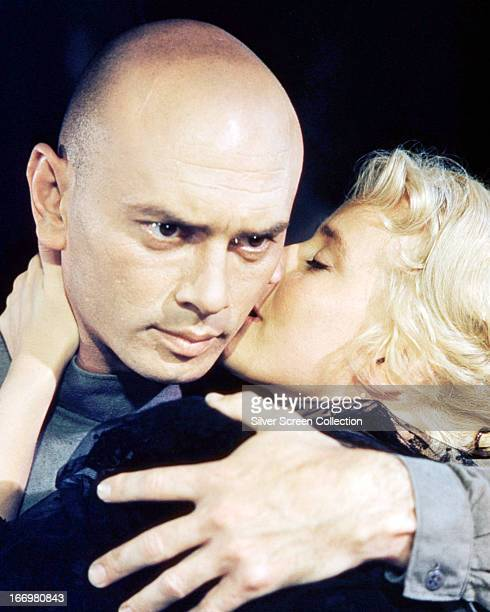 Russian actor Yul Brynner as Dmitri Karamazov and SwissAustrian actress Maria Schell as Grushenka in a promotional portrait for 'The Brothers...
