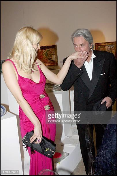 Russian actress Anna Sherbinina and Alain Delon at 'Uzbekistan 2020' Charity Dinner Gala At Musee D'Art Moderne De La Ville De Paris