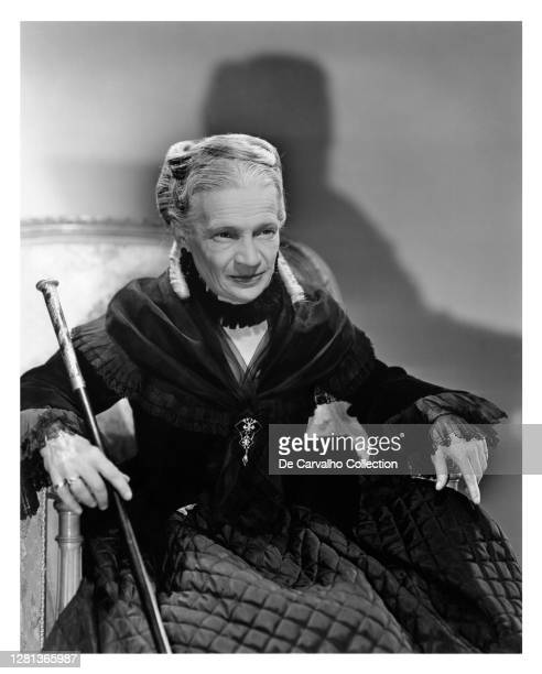 Russian Actress Madame Maria Ouspenskaya as 'Countess Pelagia Walewska' sitting on a chair and holding a walking stick in a publicity shot from the...