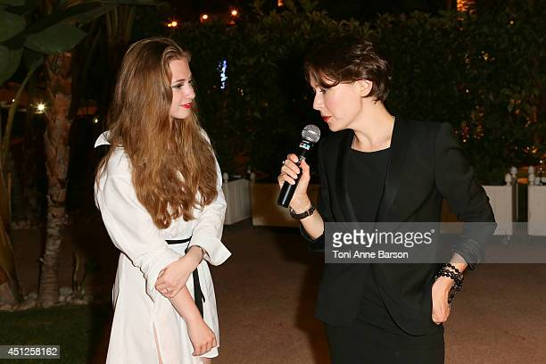 Russian Actress Producer Agata Gotova interviewing Live actress Anna Klimkina during the Chik Russian Party at the Sea Lounge Beach Club on June 25...