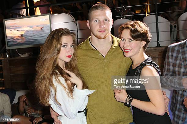 Russian Actress Producer Agata Gotova poses with actress Anna Klimkina and kickboxing world champion Vladimir Mineev during the Chik Radio Party at...