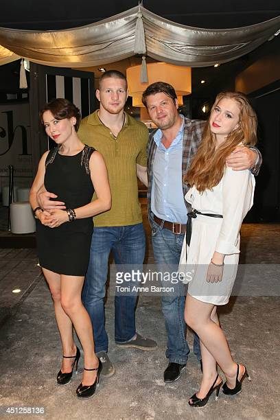 Russian Actress Producer Agata Gotova poses with kickboxing world champion Vladimir Mineev Producer Boris Grif and actress Anna Klimkina during the...