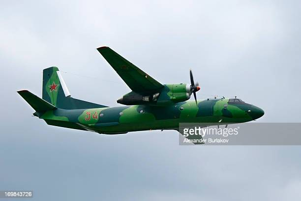 Russian Air Force Antonov AN-26 flying lab. Captured in flight in cloudy and wet weather conditions.