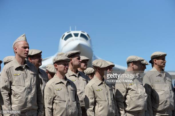 Russian Air Force personnel stand in front of a Tupolev Tu-160 strategic long-range heavy supersonic bomber aircraft upon landing at Maiquetia...