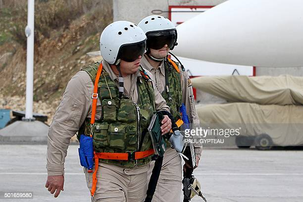 Russian air force pilots arrive to board a Russian Sukhoi Su30SM fighter jet before departure on a mission at the Russian Hmeimim military base in...