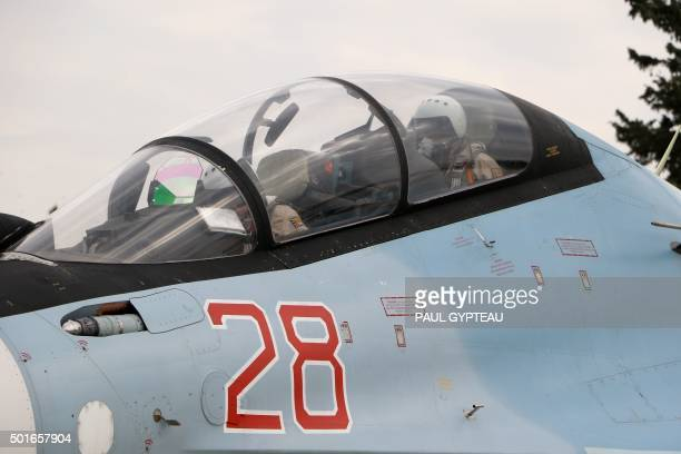 Russian air force pilots sit in the cockpit of a Russian Sukhoi Su30SM fighter jet before departure on a mission at the Russian Hmeimim military base...