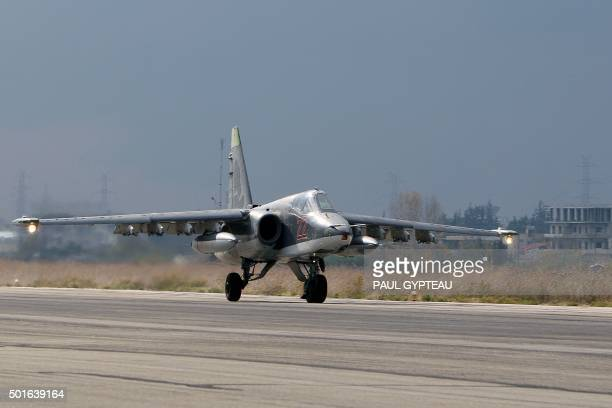 A Russian Sukhoi Su25 bomber lands at the Russian Hmeimim military base in Latakia province in the northwest of Syria on December 16 2015 Russia...