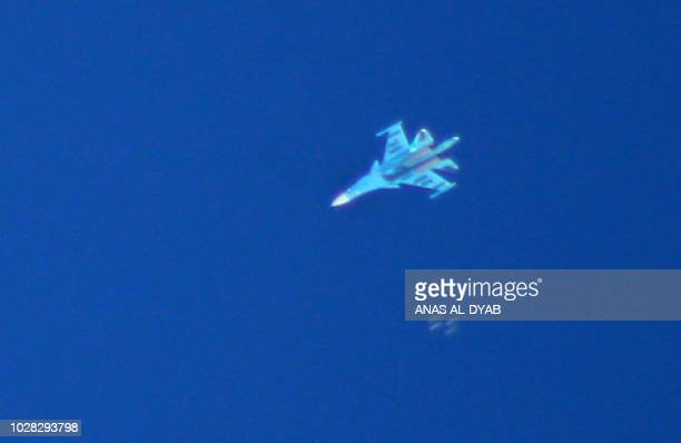 A Russian Sukhoi Su34 fighter drops bombs over the Syrian village of Kafr Ain in the southern countryside of Idlib province on September 7 2018 The...
