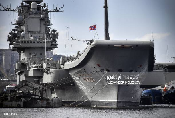 Russian aircraft carrier Admiral Kuznetsov tied up at a Rosatomflot moorage of the Russian northern port city of Murmansk on May 19 2018 Admiral...