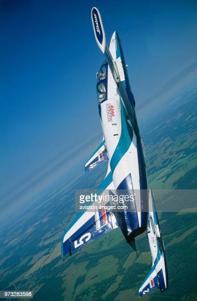 Russian AirForce Team Rus Aero Vodochody L39 Albatross formation in a vertical climb over green fields and forests