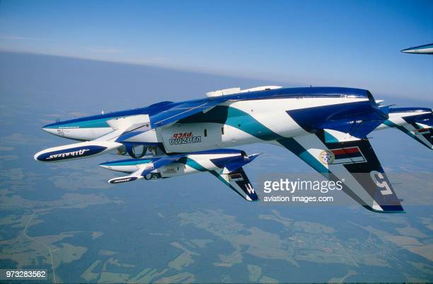 Russian AirForce Team Rus Aero Vodochody L39 Albatross formation flying inverted over green fields and forests