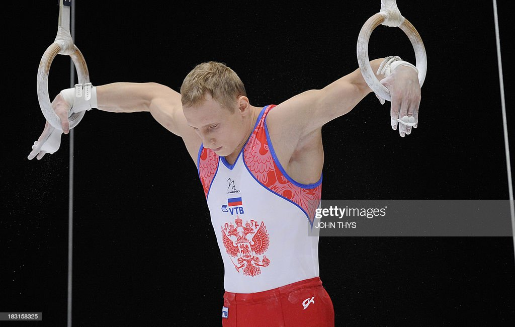 Russian Aleksandr Balandin performs during the men's rings final of the world gymnastics championships in the Antwerp Sportpaleis hall, on October 5 2013.