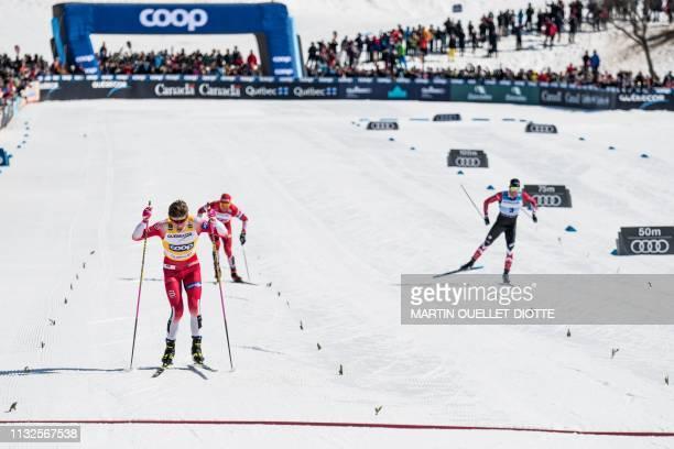 Russian Alexander Bolshunov Canadian Alex Harvey and Norwegian Johannes Hoesflot Klaebo deliver a close battle for the men's FIS World Cup Pursuit...