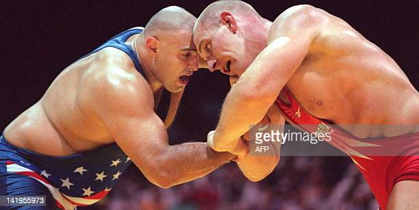 Russian Alexander Karelin and Matt Ghaffari of the US are locked head to head during their Olympic super heavyweight GrecoRoman wrestling final 23...