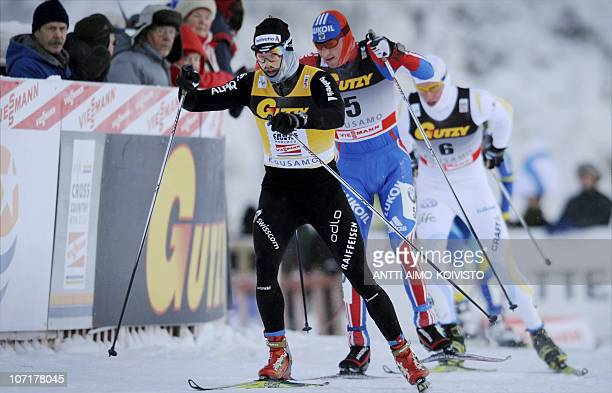 Russian Alexander Legkov Swiss Dario Cologna and Sweden's Daniel Rickardsson compete in the men's 15km freestyle cross country of the skiing World...