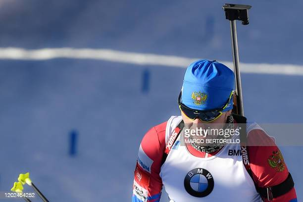 Russian Alexander Loginov crosses the finish line for Russia to place fourth of the Men 4x75 km Relay Competition at the IBU Biathlon World Cup in...