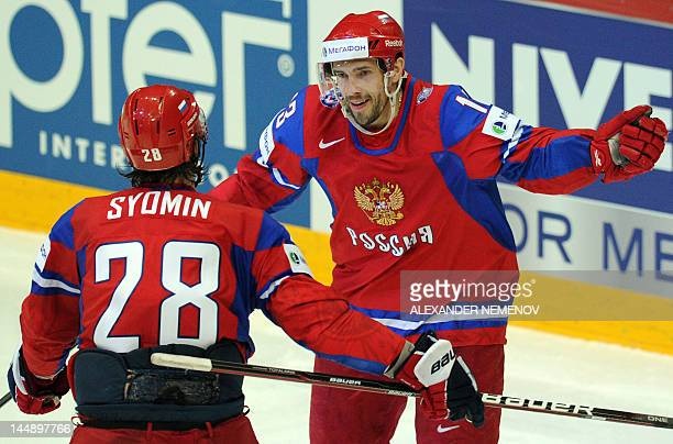 Alexander pavel datsyuk stock photos and pictures getty images russian alexander syomin and pavel datsyuk celebrate scoring against team slovakia during a final game of voltagebd Choice Image