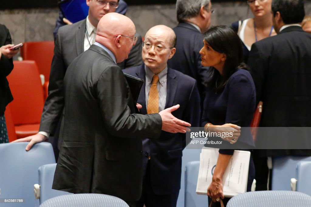 Russian Ambassador to the UN Vasily Nebenzya (L) speaks with US Ambassador Nikki Haley (R) and Chinese Ambassador Liu Jieyi (C) after a UN Security Council emergency meeting over North Korea's latest nuclear test, on September 4, 2017, at UN Headquarters in New York. The US will present a new UN sanctions resolution to punish North Korea for its sixth nuclear test and aims to put it to a vote in a week, US Ambassador Nikki Haley said Monday. 'The United States will be circulating a resolution that we want to negotiate this week and vote on Monday,' Haley told an emergency meeting of the Security Council. BETANCUR