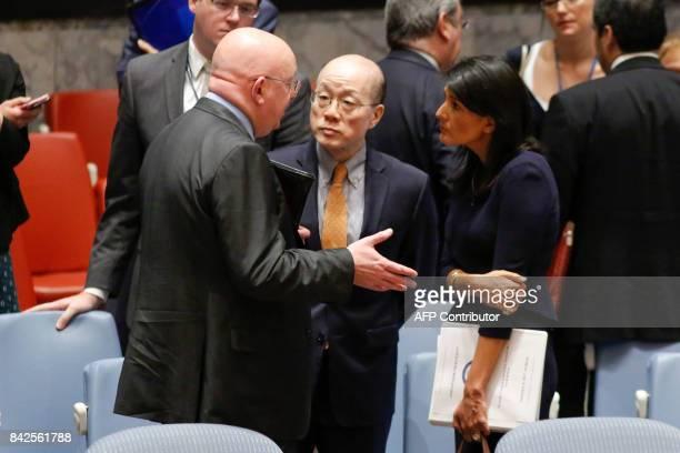 Russian Ambassador to the UN Vasily Nebenzya speaks with US Ambassador Nikki Haley and Chinese Ambassador Liu Jieyi after a UN Security Council...