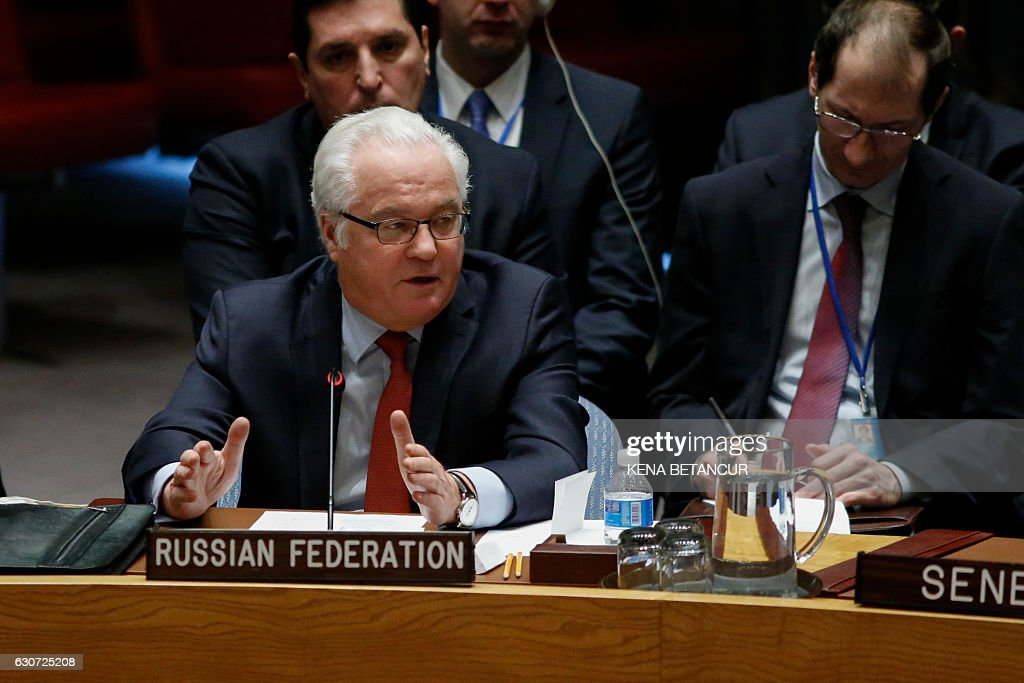 Russian Ambassador to the UN Vitaly Churkin speaks at the UN Security Council on a Russian-Turkish peace plan for Syria, on December 31, 2016, at UN Headquarters in New York. The Security Council unanimously approved the resolution. / AFP / KENA