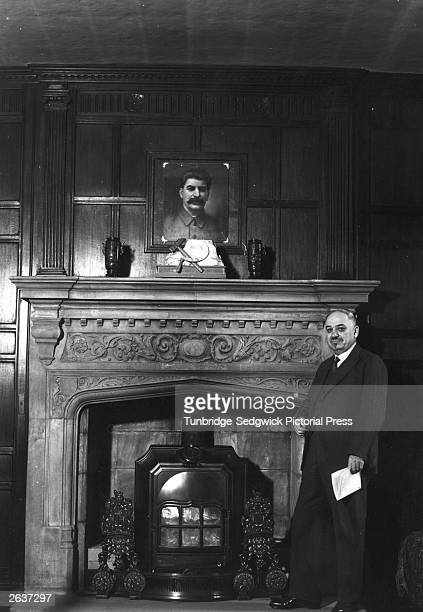 Russian Ambassador to the United Kingdom Ivan Michaelovich Maisky at the Russian Embassy standing below a picture of Stalin July 1940