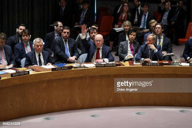 Russian Ambassador to the United Nations Vasily Nebenzya votes yes for a Russian proposed draft resolution that would condemn the aggression against...