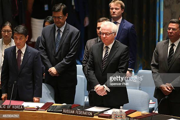 Russian Ambassador to the United Nations Vitaly Churkin pauses during a moment of silence for victims of the downed Malaysia Airlines passenger jet...