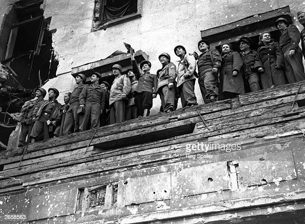 Russian American and British troops on the balcony of Hitler's Chancellery in Berlin